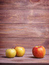Three apples on wooden boards Stock Photography