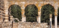 Three arches of stone within a roman ruins site Royalty Free Stock Image