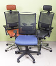 Three armchairs high end office chairs covered with red and black leather and blue cover Royalty Free Stock Photo