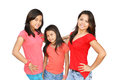 Three asian girls beautiful posing with red t shirts blue pants Stock Image