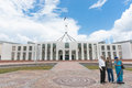 Three Asian tourists outside Australian Parliament House in Canb