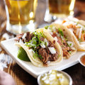 Three authentic mexican tacos barbacoa carnitas and chicken Stock Photography