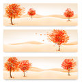 Title: Three autumn abstract banners with colorful leaves and trees.