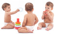 Three babies play on the floor montage Royalty Free Stock Image