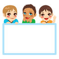 Three baby boys of different ethnicities with a blue frame white billboard Stock Images
