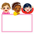 Three baby girls of different ethnicities with a pink frame white billboard Stock Photography