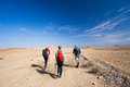 Three backpackers. Royalty Free Stock Photo