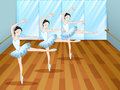 Three ballet dancers inside the studio Stock Image