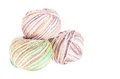 Three balls of colored cotton knitting yarn Stock Photos