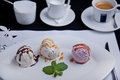 Three balls of ice cream on a plate Royalty Free Stock Image