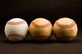 Three balls a new baseball and two old baseballs Royalty Free Stock Photography