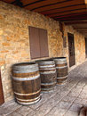 Three barrels old wooden of wine on village street Royalty Free Stock Photos