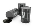 Three barrels and spilled oil Royalty Free Stock Photos