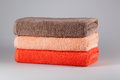 Three bath towels of different colors Royalty Free Stock Photo