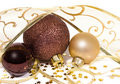 Three baubles with twisted ribbon garlands Royalty Free Stock Photo