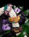 Three beaded bracelets on jasmine flowers Stock Images