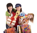 Three beautiful girlfriends enjoy shopping. Royalty Free Stock Photo