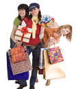 Three beautiful girlfriends enjoy shopping. Royalty Free Stock Photos