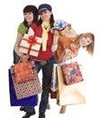 Three beautiful girlfriends enjoy shopping. Royalty Free Stock Photo