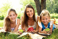 Three beautiful girls relaxing in park Royalty Free Stock Photography