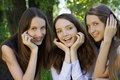 Three beautiful smile student girl in park Stock Image