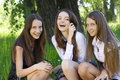 Three beautiful smile student girl in the park Royalty Free Stock Photography