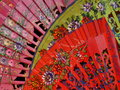 Three beautiful spanish fans close up of a selection of brightly coloured floral Stock Photos