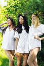 Three beautiful woman in a man's shirt on nature Royalty Free Stock Photo