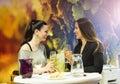 Three beautiful woman two women having fun in a wine bar Royalty Free Stock Photo