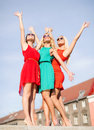 Three beautiful women in the city Stock Image