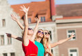 Three beautiful women in the city holidays and tourism friends hen party blonde girls concept waving hands Stock Photography