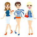 Three beautiful women dressed summer fashion clothing Royalty Free Stock Photography