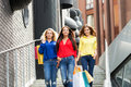 Three beautiful women going down the street stairs after shopping in mall Royalty Free Stock Photography