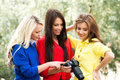Three beautiful women having a photosession in the park Royalty Free Stock Photo