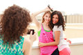 Three beautiful women photographing themselves Royalty Free Stock Photo