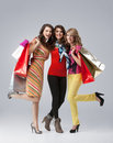 Three beautiful young women holding shopping bags Royalty Free Stock Photo