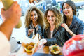 Three beautiful young women visiting eat market in the street. Royalty Free Stock Photo