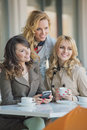 Three best friends in the coffee shop cosy Royalty Free Stock Image