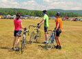 Three bike riders at post cycling event Berkshires MA Royalty Free Stock Photo