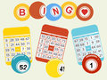 Three bingo balls and cards on light green background