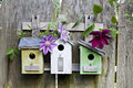Three birdhouses on old  wooden fence Royalty Free Stock Photo
