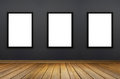 Three Black frame hanging on a grey wall.white isolate.perspective wooden floor.for advertiser.graphic design