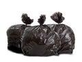 Three black rubbish bags on white background Stock Photos