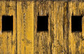 Three black windows on the wood door Royalty Free Stock Photography