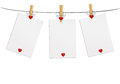 Three blank paper with red heart hanging on the wooden cloth peg