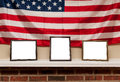 Three blank photo frames on a shelf with american flag background Royalty Free Stock Photo