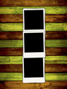 Three Blank Photos on Colorful Wooden Backgroun Royalty Free Stock Photo