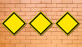 Three blank yellow traffic sign Stock Images