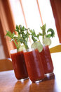 Three Bloody Mary Cocktail Drinks Stock Image