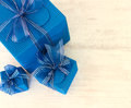 Three blue carton gift boxes Royalty Free Stock Images